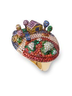 19,2k Gold ring. Diamonds, Sapphires and Emeralds