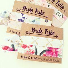 Bride Tribe Floral Bachelorette Hair Tie Favor // Boho Hair Tie Bridesmaid Gift, Aztec Tribal Boho Bachelorette Party, Arrows Floral Prints by LoveMiaCo on Etsy https://www.etsy.com/listing/278522030/bride-tribe-floral-bachelorette-hair-tie