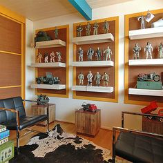 """Collection display- might be good for lego display ""Nice modern display for a toy collection!"" ""Shelf frames for figures / statue display"" ""Kitchen Wall display"" ""Way to display toy collection"" ""possible memorabilia display idea"" ""Collection displayed"""