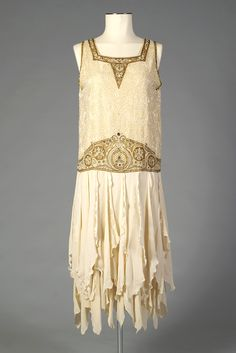 Dress of cream silk crepe with design embroidered with pearls, rhinestones, metallic thread, and amber beads, American, ca. 1925, KSUM 1996.58.228.