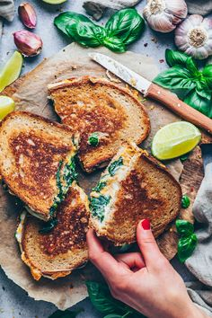 This quick and easy vegan grilled cheese sandwich recipe is so delicious, you will not miss the real deal! It& made with a dairy-free creamy vegan cheese spinach filling that can be stuffed into any kind of (gluten-free) sandwich bread! Grill Cheese Sandwich Recipes, Easy Sandwich Recipes, Grilled Sandwich, Chicken Sandwich, Steak Sandwiches, Sandwich Ingredients, Grilled Pizza, Burger Recipes, Pizza Recipes
