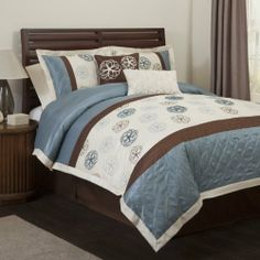 Triangle Home Fashions 18221 Lush Decor 6-Piece Covi Comforter Set, King-Size, Blue/Brown by Triangle Home Fashions. Save 52 Off!. $132.79. Available in Blue/Brown, Black/White. 6-piece set includes: one comforter, one bedskirt, two pillow shams, and two dec. pillows. Care; dry clean. 250 gsm comforter. Faux silk and microfiber. Mix of ribbon and embroidered floral detail. Matching bedskirt, shams and throw pillows provide finishing touches. In Blue/Brown.