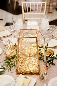 Floral Wedding Centerpieces Planning and Tips - Love It All Lantern Centerpiece Wedding, Lighted Centerpieces, Wedding Lanterns, Wedding Table Centerpieces, Wedding Flower Arrangements, Wedding Favors, Wedding Decorations, Table Decorations, Centerpiece Ideas