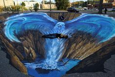 Pheonix 3D Street Art. Street painting of an Eagle rising from a gesyer of water.