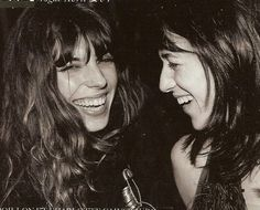 love this rare pic of these typically too-cool sisters laughing: lou doillon and charlotte gainsbourg