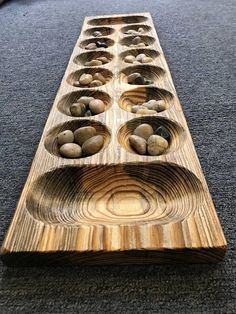 """Mancala Stone Gem extra large Game Board solid wood 3 by 9"""" by 2. The game Mancala originated over 7000 years ago in West Africa. Mancala Stone/Gem Game. LCWW 2017 is carved on the back. This Mancala Wooden Game Board is rough, primitive, rustic looking, the one pictured is the one"""