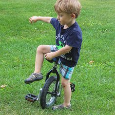 PHASE II TODDLER UNICYCLE TRAINING : Three Year Old Begins Lapless Freemounting Attempts  Today was the first time he ever tried free mounting a unicycle. I said nothing to him. I put the unicycle down, backed away and snapped some photos.  Unicyclists: Notice how his upper body is in perfect form the first time he picks it up?  (Please disregard how his first foot is still on the ground, not on pedal…) #SAHD #unicycle #unicycling #playMatters #kidsFitness #activeKids #activeFamilies Unicycle, Three Year Olds, Exercise For Kids, Upper Body, First Time, Activities For Kids, Dads, Training, Photos