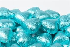 """Tiffany blue chocolate hearts $11.95/lb {a theme party perhaps? Breakfast day after """"at Tiffany's""""? Hmmm} maybe just a """"Tiffany favor idea for rehearsal (if we go w/favors) or reception.  Ideas Ideas!"""
