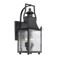 Dynamic and versatile, this outdoor wall light pairs water glass panels with a deep charcoal finish. Outdoor wall light from the Plantation Collection. Style # at Lamps Plus.