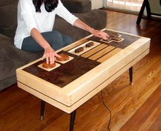 Functional Nintendo Controller Coffee Table.  The ultimate show off piece for geeks the world over.