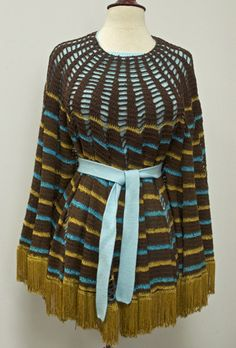 Another cool table cloth made into a poncho! Crochet is tricky and very fiddly because all those ends one has to tie off at the neckline!