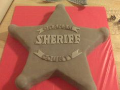 I like the shape but would do a different color. Cowboy birthday cake - sheriff badge