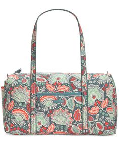 "Fun, fashionable and perfectly-sized for weekends away, this spacious duffle packs plenty of style in its durable quilted construction. By Vera Bradley. | Cotton | Imported | Large sized bag; 22"" W x"
