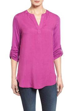 Adding a bright pop of purple to the work wardrobe with this easy-to-wear tunic that pairs perfectly with dark denim and flats. This Anniversary Sale find comes in a variety of colors that will be a great addition to the closet.