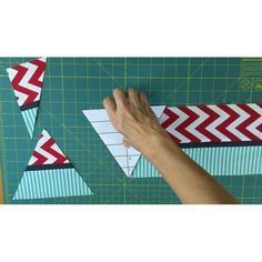 Make triangles from fabric strips for quilt blocks!