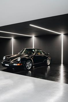 Think Architecture's expertly executed vision for their House for an Art Collector is a minimalist's dream. A residential 'blank' canvas of so. Garage Lighting, Lighting Showroom, Garage House, Dream Garage, Car Garage, Showroom Design, Interior Design, Yvoire, House Architecture