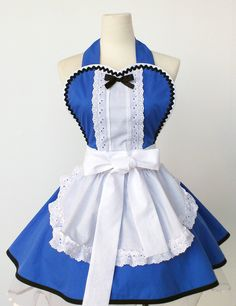 If I only I were more domestic...  Alice in Wonderland Apron -Made to Order. $52.00, via Etsy.