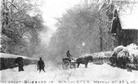 Winchester: snow scene with horse and cart and standing figures, one with an umbrella, captioned: 'The Great Blizzard in Winchester, Worthy Road, 25.4.08'
