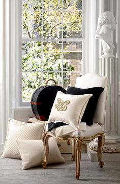 """The """"RL"""" tate throw pillow, in luxurious silk with beaded embroidered monogram, adds instant refined glamour to bedding"""