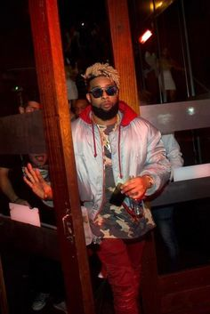 Odell Beckham Jr. wearing Vetements Alpha Industries Quilted Reversible Bomber Jacket, Dior 'Abstract' 58mm Sunglasses, Amiri Skinny Jeans