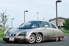 The Eliica (or the Electric Lithium-Ion Car) is an eight-wheeled electric car designed by a team from the Keio University in Tokyo, Japan. In 2004, it reached a top speed of 230mph.