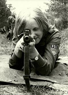 Youth club for sport and technics run by the FDJ of the #GDR - involved in para military education. What an attractive woman..