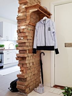 """reclaimed brick """"wall"""" in an otherwise new and white environment. dig that balance."""