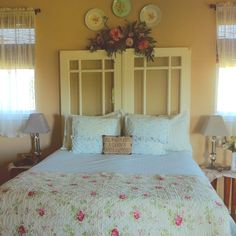 My bedroom with the antique French doors I made for a headboard!!