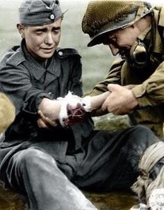 Historical throwback. American soldier helping a wounded German soldier in 1944