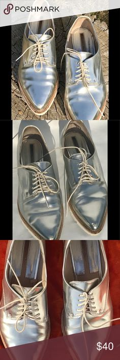 Zara Silver Metallic Boucher Lace Up Oxford 8 2015 so her patent Blucher Lace-up metallic Oxford. Size 7 1/2. The size is 38, but I am a size 8 and they're a little tight on me.Silver patent leather.White sole with natural color contrast. In pretty good condition. There is some scuffing on the toe, and some other marks consistent with wear.  They are pictured. Zara Shoes Flats & Loafers