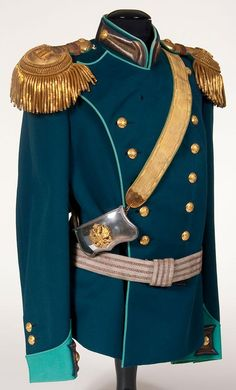 AN IMPERIAL RUSSIAN NAMED UNIFORM GROUP OF THE COMMANDER OF THE 2ND FRONTIER GUARD REGIMENT, CIRCA 1910.  Formerly the property of Colonel Adolf Edwardich Gahlnbeck  Blue wool double breasted tunic with green collar, cuffs and piping.  Collar and cuffs with gold bullion Litzen and buttons on a blue field.  Left chest with tailored hole for award.