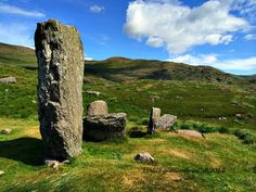 The Uragh stone circle in Tuosist, on the beara Peninsula in Kerry, Ireland. Five standing stones, plus a HUGE outlying monolith stone 10 feet tall! We were awed by the circle and the stunning views of Kerry. #Standingstones #Ireland   uragh-stone-circle-monolith
