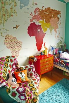 I like the wall map, and the mix of colors and vintage looking pieces that all work together. I think this is one of my favorites