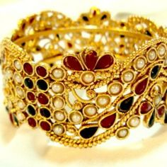 Wide Goldtone Bangle with Rubies, Emeralds and faux pearls $50.00