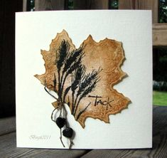 By Birgit Edblom (Biggan at Splitcoaststampers). The leaf is die-cut. Neat idea to stamp on a large die-cut! Misted with gold glimmer mist.