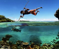 On the island of Mare in the island chain of New Caledonia in the southwest Pacific, a fisherman uses a traditional method of fishing.