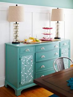 Update a dark wood sideboard with bright paint and sparkling hardware. A paint pen makes fast work of the geometric design on the doors. More DIY furniture makeovers: http://www.midwestliving.com/homes/decorating-ideas/22-easy-furniture-makeovers/page/19/0
