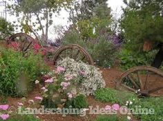 Grab some wagon wheels and build an informal fence -- like in this garden