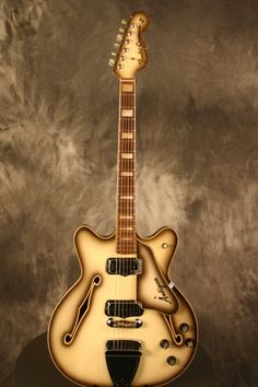 1968 Fender Coronado, in Antigua. One of the weirdest/ugliest finishes ever. I love it.