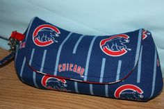 I just finished up this bag tonight! I was waiting for the purse hardware to come in the mail. This clutch is actually a Christmas gift for a huge Cubs fan. At this point in time, apparently all the cotton Chicago Cubs fabric is out of print. I saw that they had it on ebay… Read More
