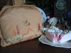 Etsy listing at https://www.etsy.com/listing/204924395/vintage-1930s-satin-tea-cosy-embroidered