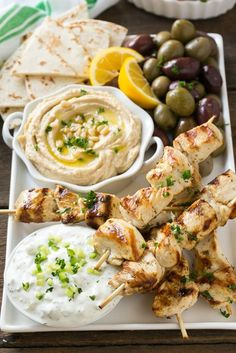 This recipe for Greek chicken souvlaki is skewers of tender chicken breast marinated in lemon, garlic and herbs, then grilled to perfection and served with a creamy yogurt sauce. These chicken souvlaki kabobs are a Healthy Dinner Recipes, Cooking Recipes, Grilling Recipes, Summer Recipes, Easy Recipes, Amazing Recipes, Heart Healthy Meals, Beef Recipes, Healthy Movie Snacks