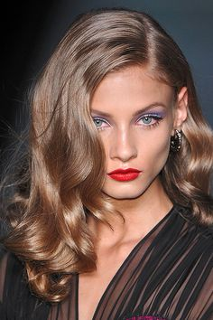 Beauty image from the Dior spring 2010 runway show - I love the loose waves, red lips and periwinkle eyeshadow.