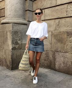 White tee + denim mini = a perfect look for the heat from @wethepeoplestyle Discover more Scandi bloggers here- http://lifestyle.one/grazia/fashion/trends/scandinavian-style-fashion-bloggers-instagram/