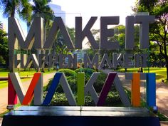 Sign at the entrance to a park in Manila saying Make It Happen Make It Makati