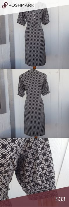 "Black Tan Front Button Down Pullover Midi Dress A little oversized elbow sleeves.  Front button up dress in great shape. Stretchy and comfortable fabric. Shirt dress. Polyester and spandex. Approximately 21"" armpit to armpit. Approximately 41"" long. Jaclyn Smith Dresses Midi"