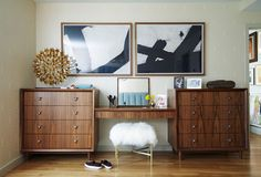 Bohemian Midcentury Bedroom: A midcentury style brown wood vanity with a plush white and gold stool..
