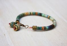 rope bracelet with handmade copper textile beads on Wanelo