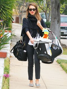 i like her purse/diaper bag, shades, scarf and flats. she would make carrying a baby carrier look chic :)