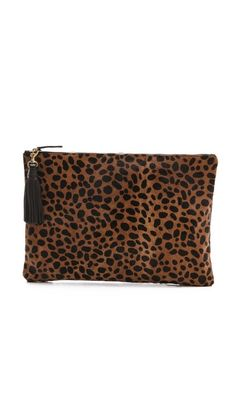A little leopard / CLARE VIVIER Oversized Haircalf Clutch with Tassels